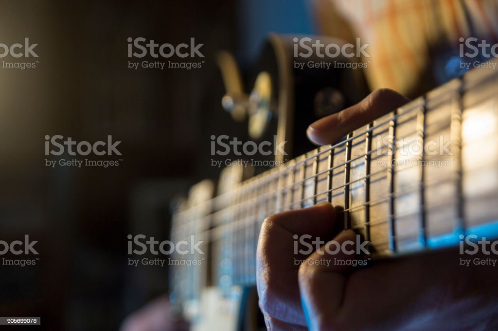Guy is playin electric guitar stock photo