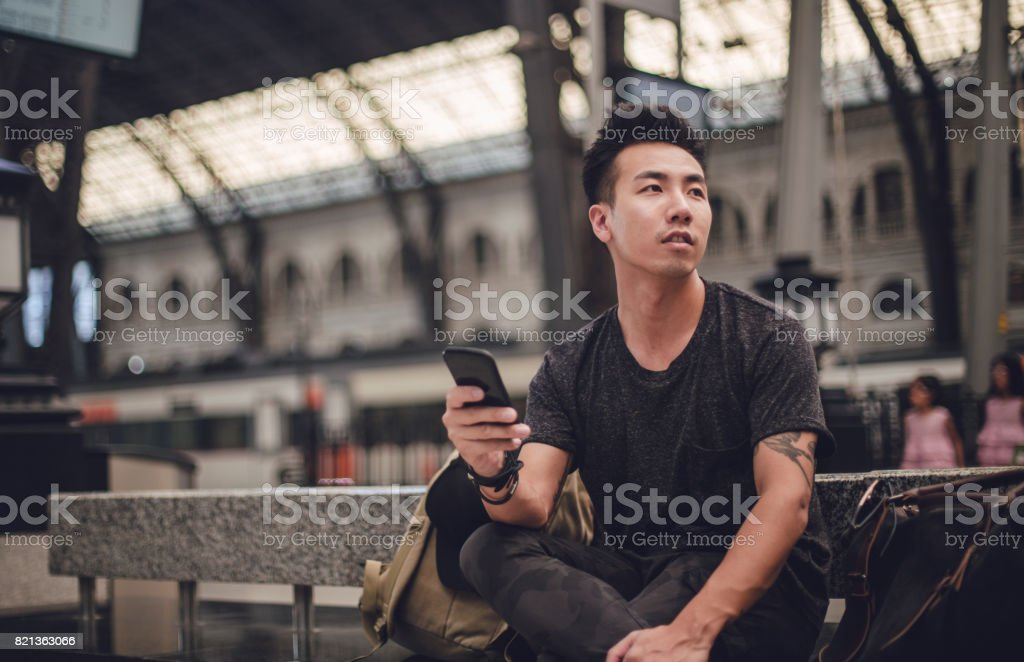 Guy leaving town stock photo