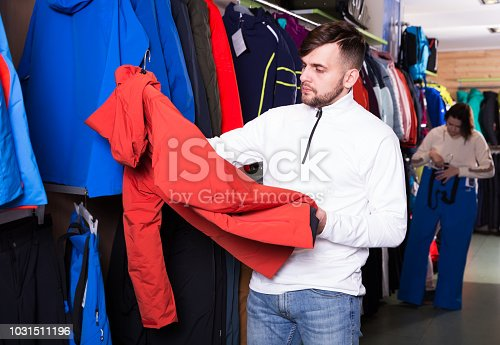 istock Guy looking for skiing clothing 1031511196