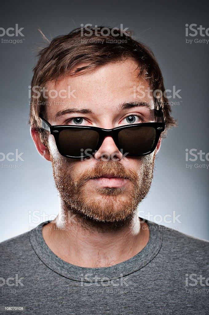 Guy looking over wayfarers stock photo