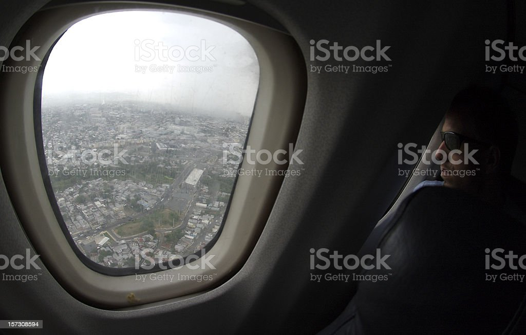 Guy Looks Out Airplane Window stock photo