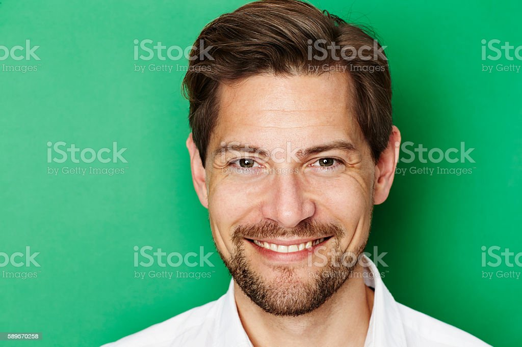 Guy on green stock photo