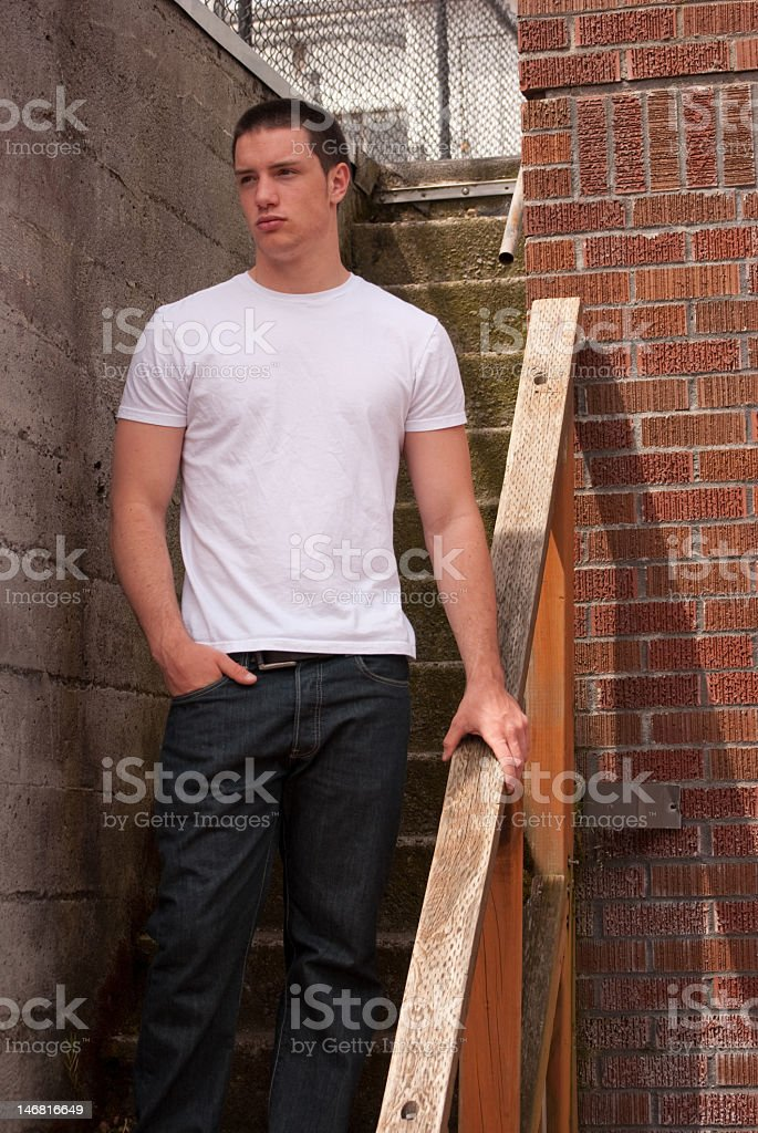 Guy on stairs stock photo