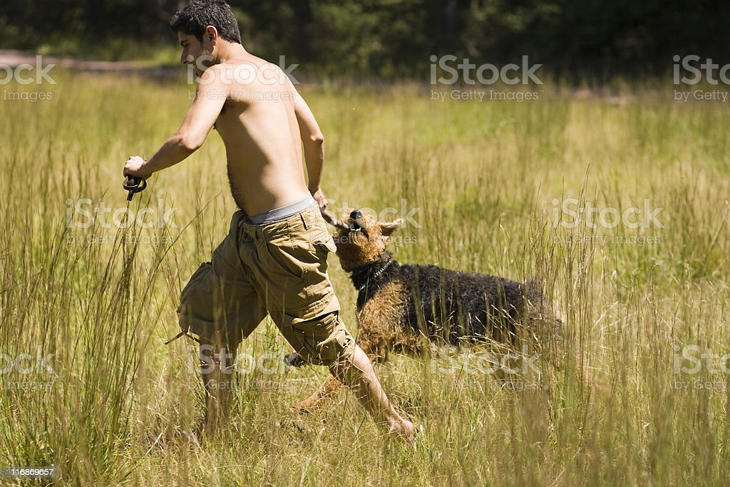 guy play with dog royalty-free stock photo