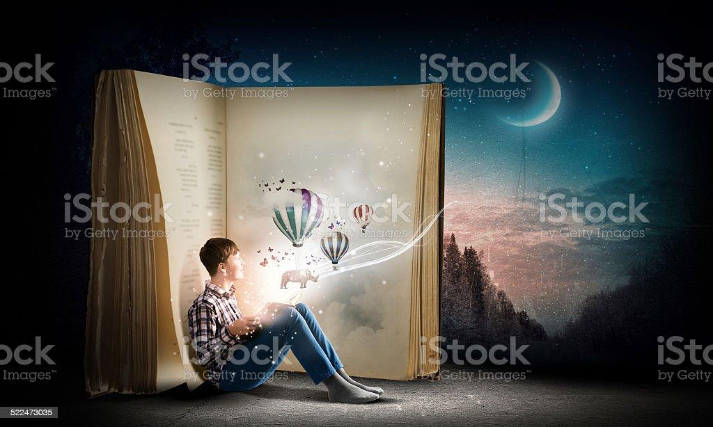 Guy reading book stock photo