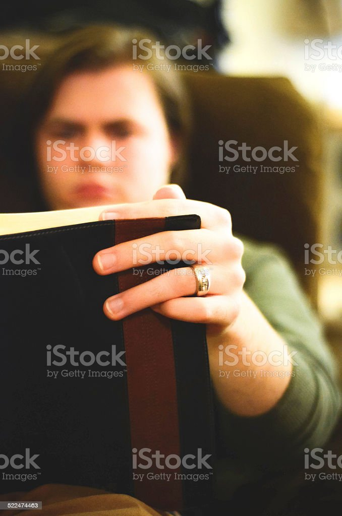 Guy Reading the Bible stock photo