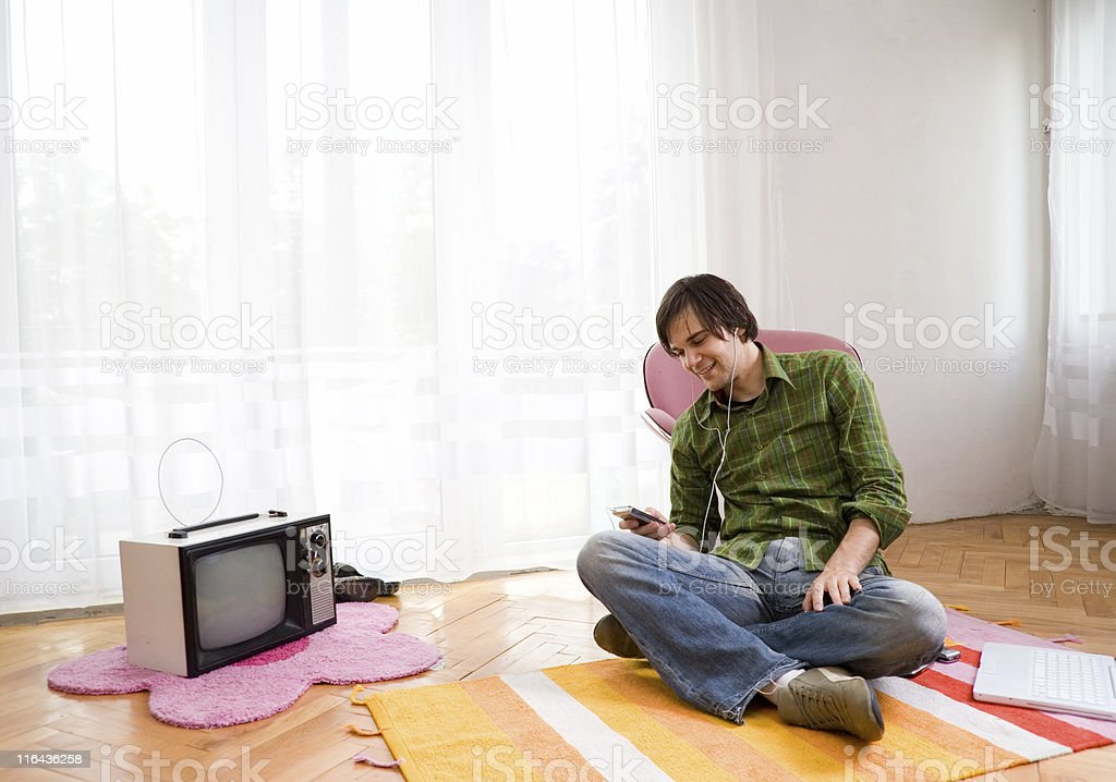 Guy relaxing while listening to music royalty-free stock photo