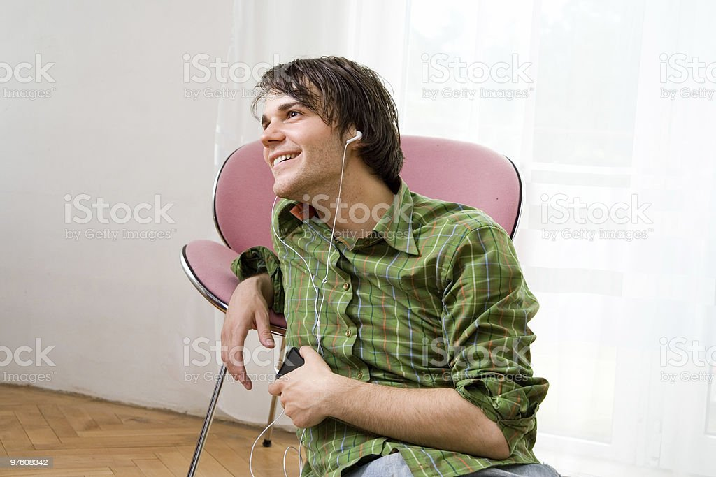 Guy relaxing while listening to music royaltyfri bildbanksbilder