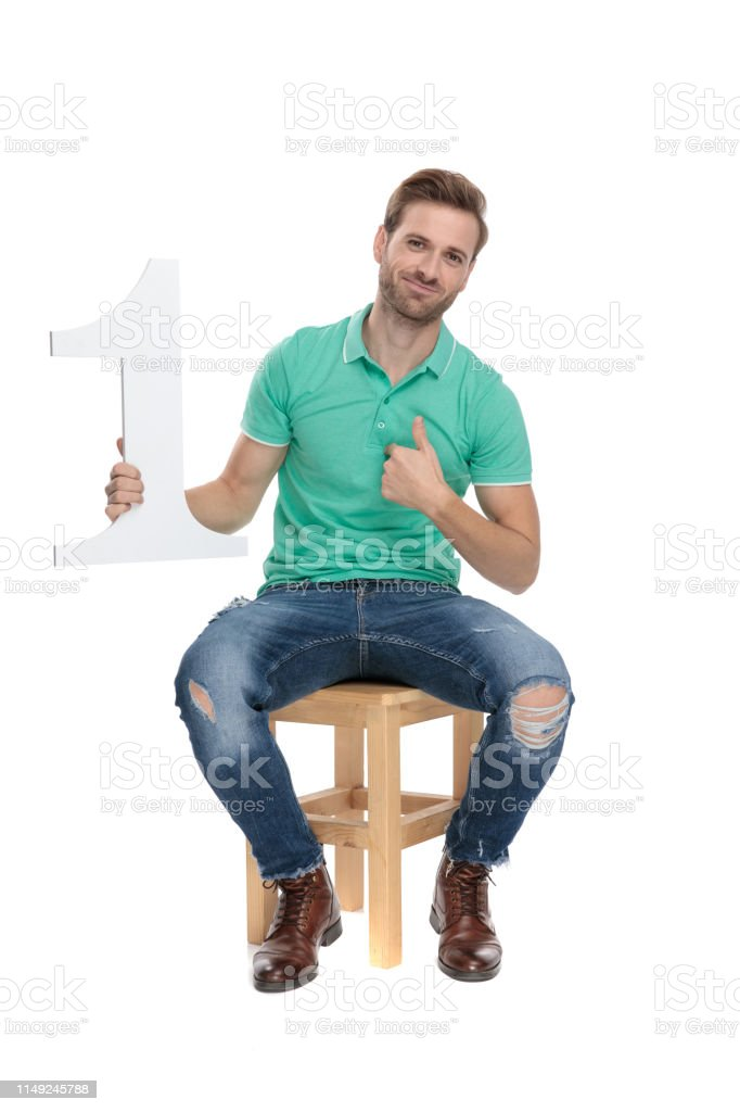 guy showing ok gesture with number one sign in hand stock photo