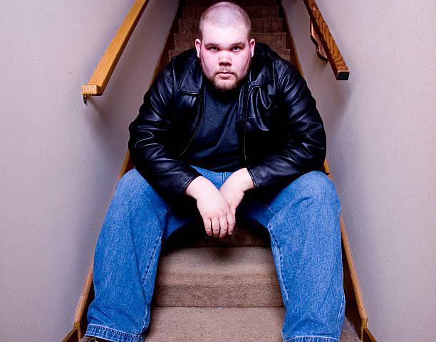 Guy sitting on stairs 3 - color stock photo