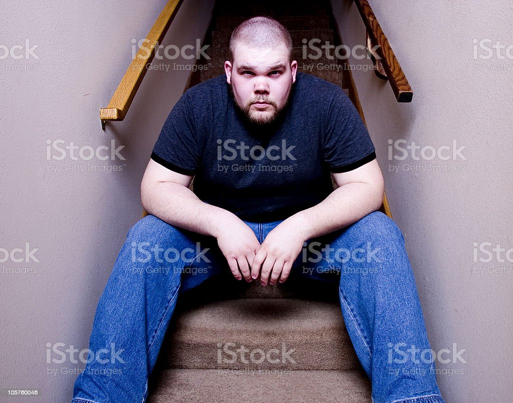 Guy sitting on stairs 5 stock photo