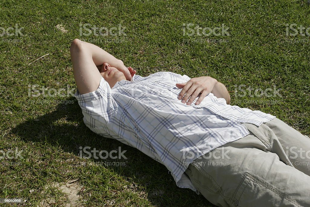 Guy sleeping on grass royalty-free stock photo
