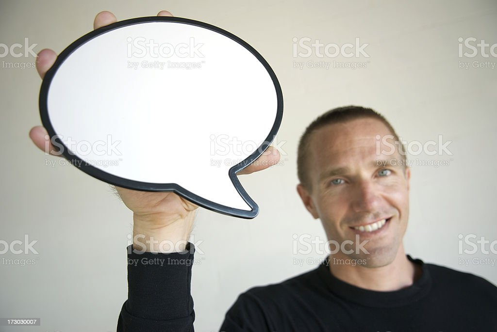 Guy Smiles Holding Speech Bubble royalty-free stock photo