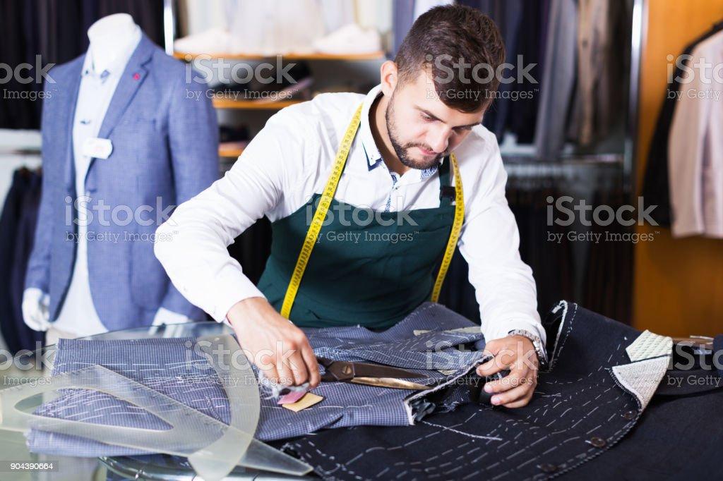guy snipper  in modern workshop stock photo