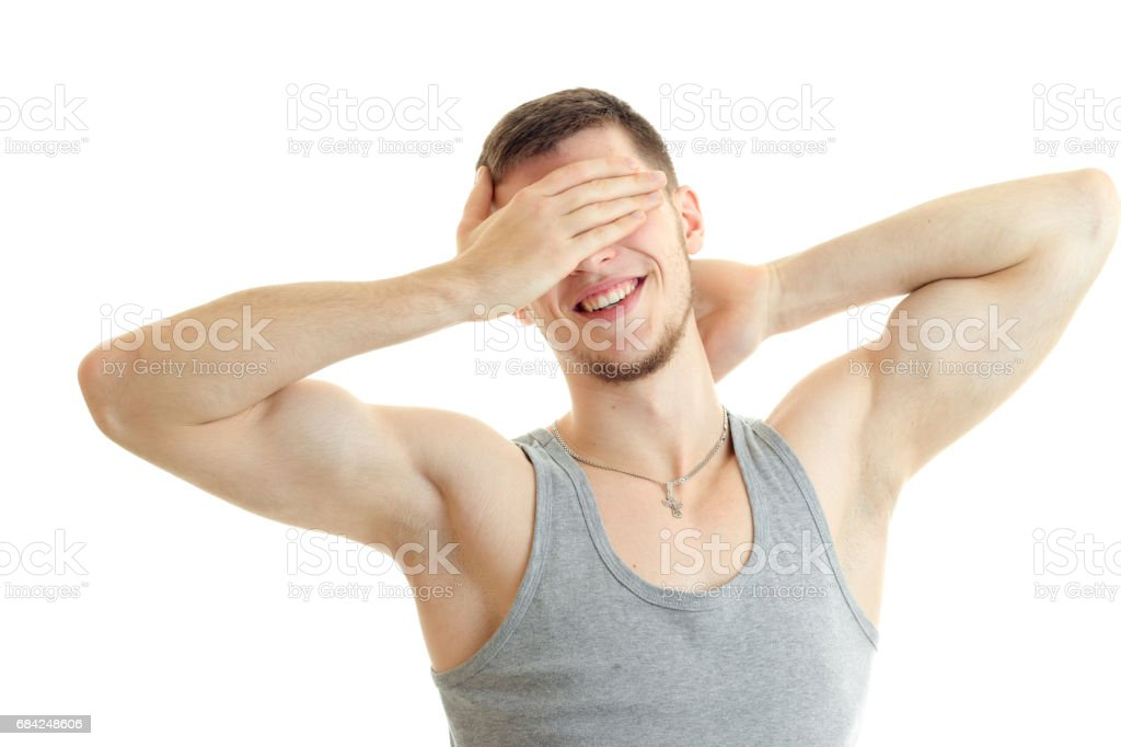 guy stands in front of the camera, smiles and closes the hand face royalty-free stock photo