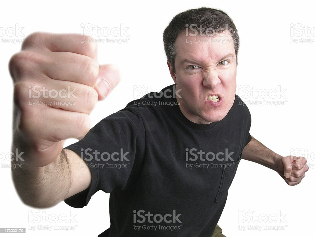 Guy throws a punch royalty-free stock photo
