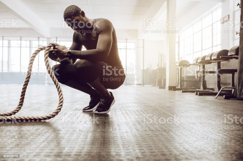 guy training at the gym stock photo