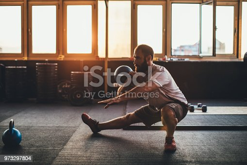 istock Guy training with weights 973297804