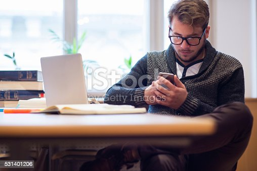 istock Guy using smartphone and laptop 531401206