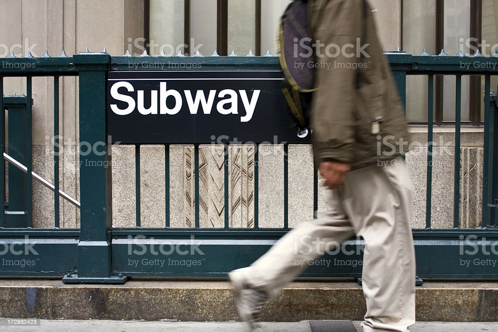 Guy walking by Subway stop stock photo