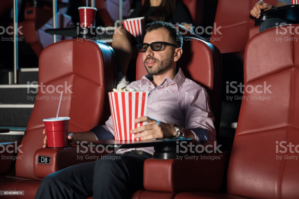 Guy watching a 3d movie by himself stock photo