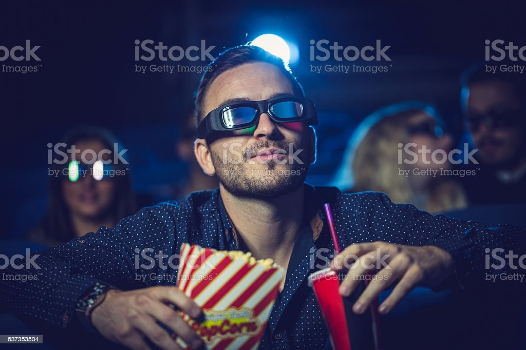Guy watching a movie stock photo