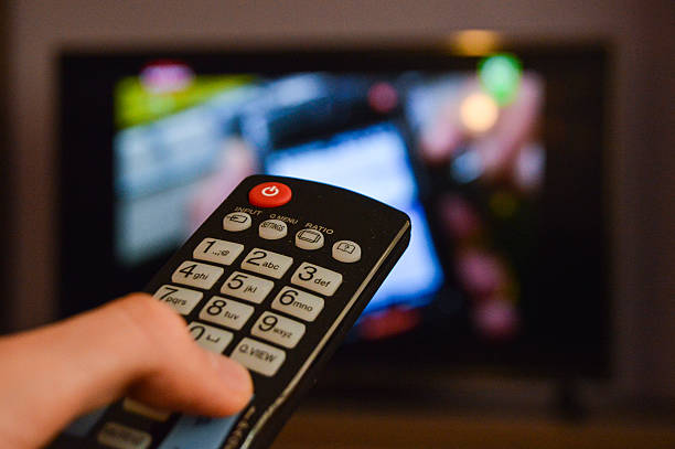 Guy watching television stock photo