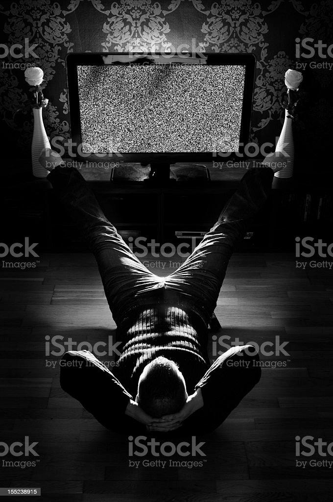 Guy Wathcing tv stock photo