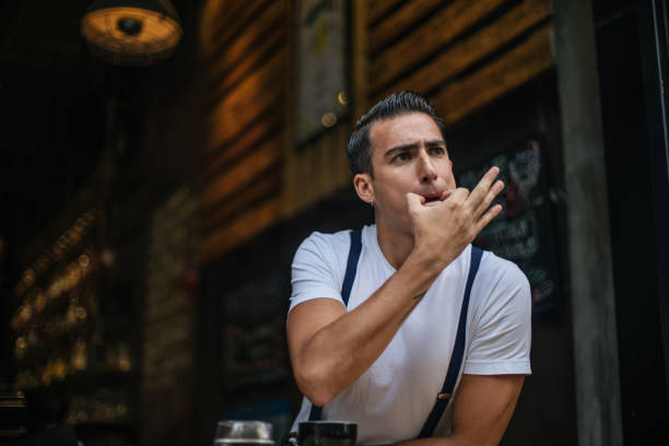Guy whistling stock photo
