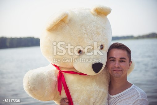 505935220istockphoto Guy with a big teddy bear 485117206