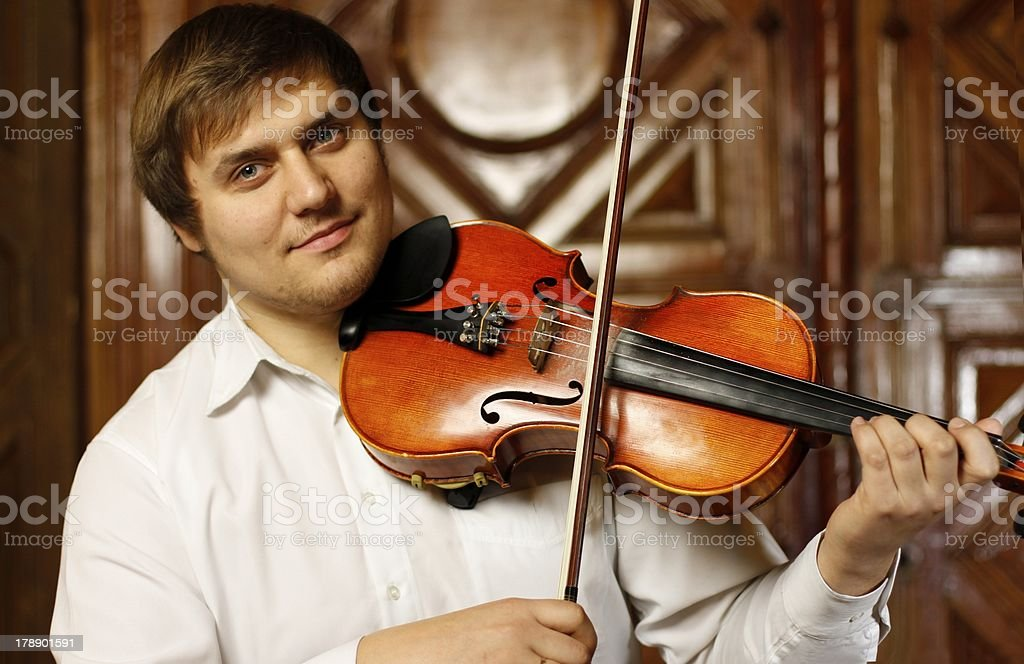 Guy with a violin royalty-free stock photo