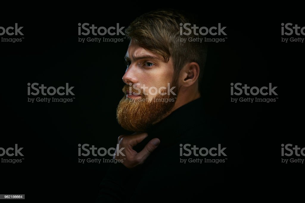 Guy with beard thoughtful, pensive, charming, looking forward stock photo