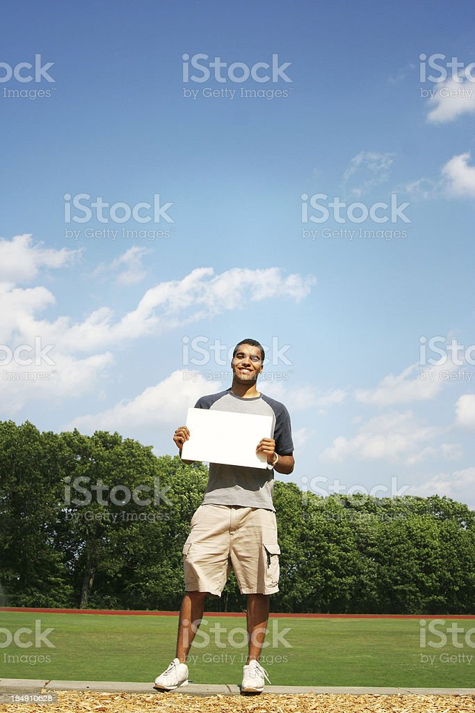Guy with blank sign royalty-free stock photo