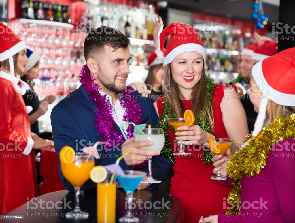 Guy with girls on new year eve party in bar stock photo