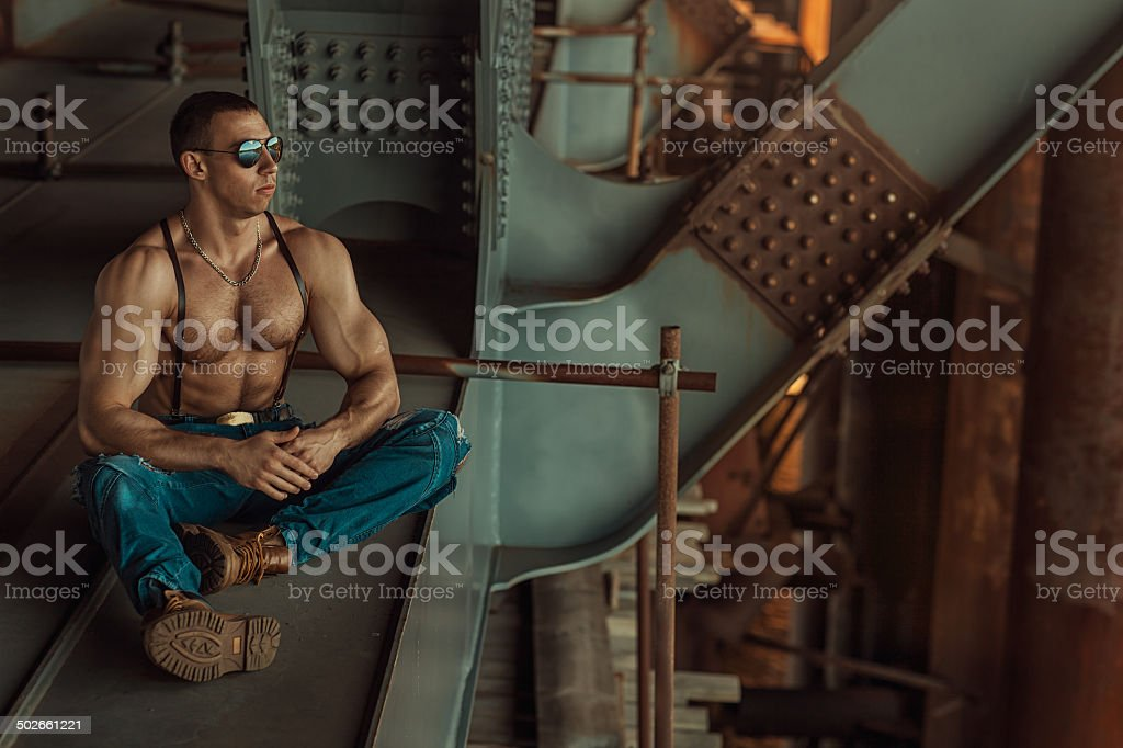Guy with glasses sitting. stock photo