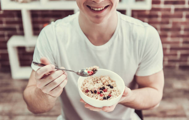 Guy with healthy food stock photo