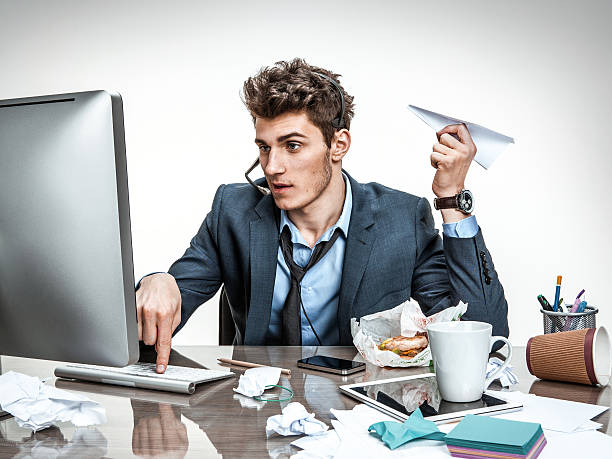 guy with paper plane typing on a computer - dawdle stock pictures, royalty-free photos & images