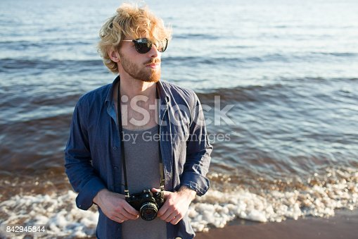 istock Guy with photocamera 842945844