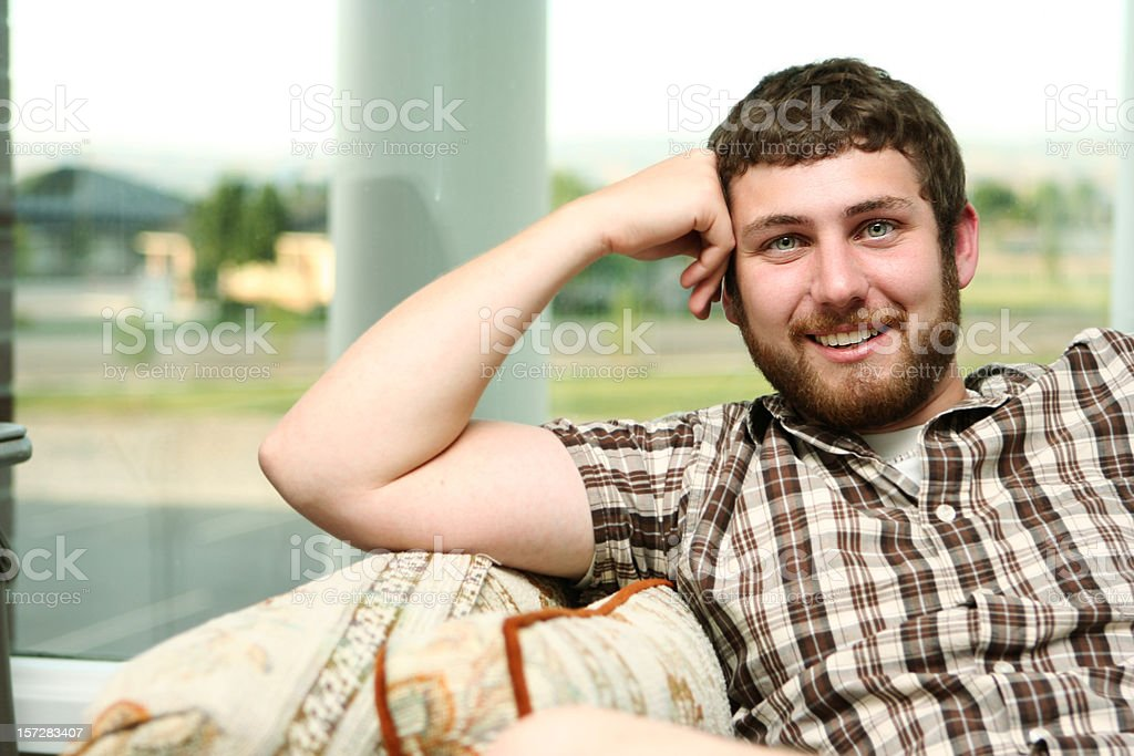 Guy with Plaid Shirt Smiling royalty-free stock photo