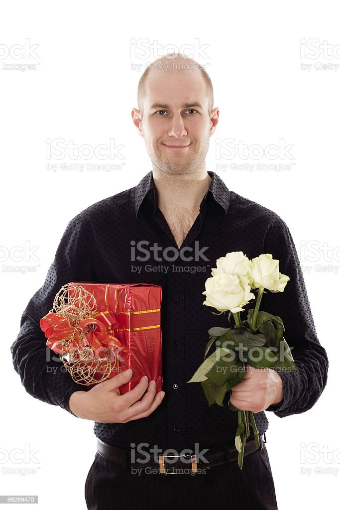 Guy with roses and a gift box royalty-free stock photo