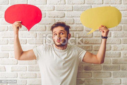 istock Guy with speech bubble 622454234