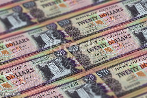 istock GYD. Guyana currency background. Guyana dollars banknotes. Georgetown 1195626128
