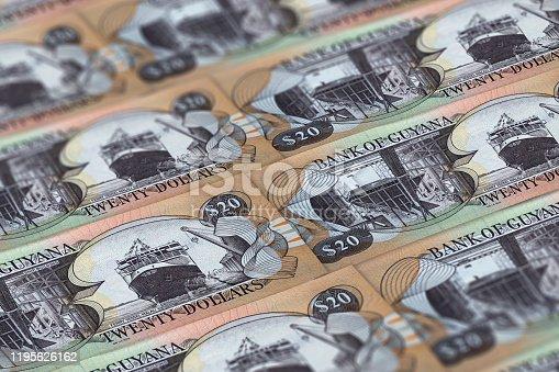 istock GYD. Guyana currency background. Guyana dollars banknotes. Georgetown 1195626162