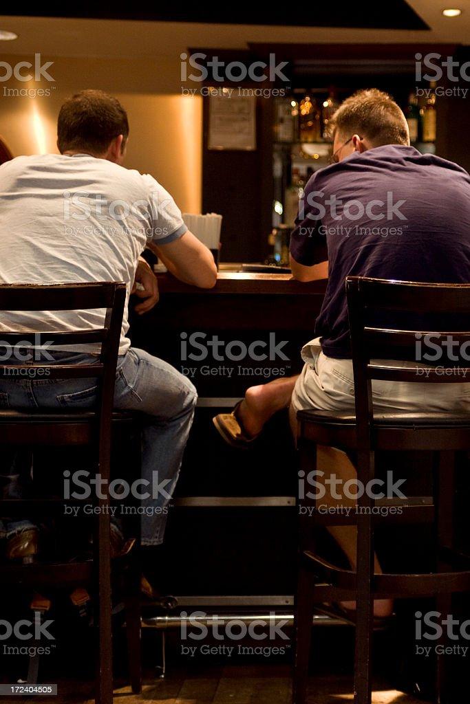 Guys at a bar stock photo