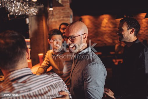 933516938 istock photo Guys in night out 933517304