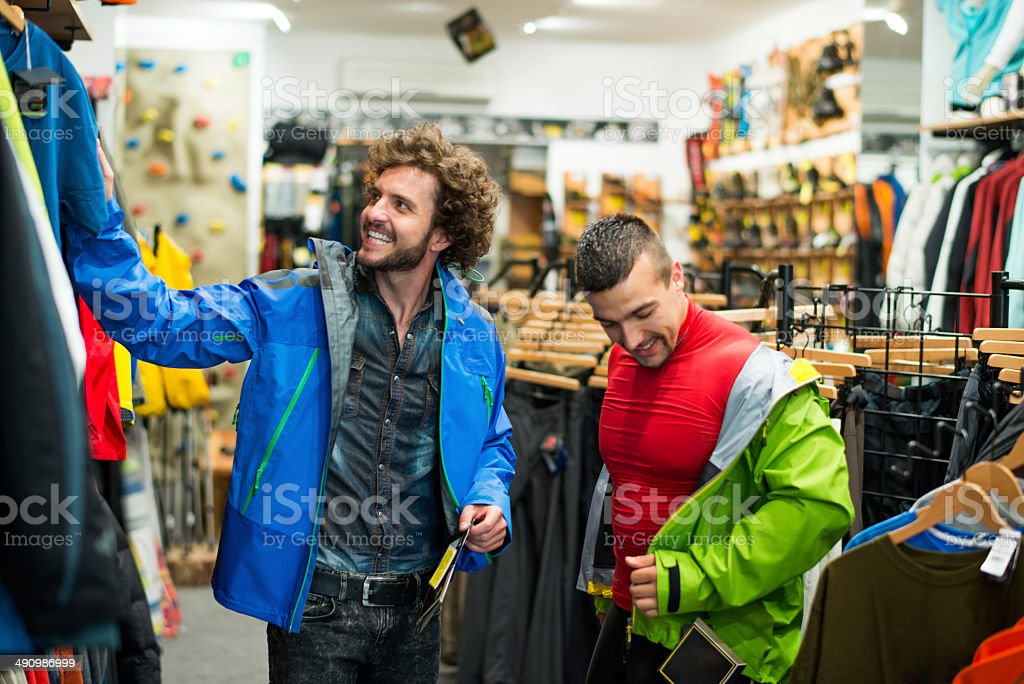 Guys in sports store stock photo