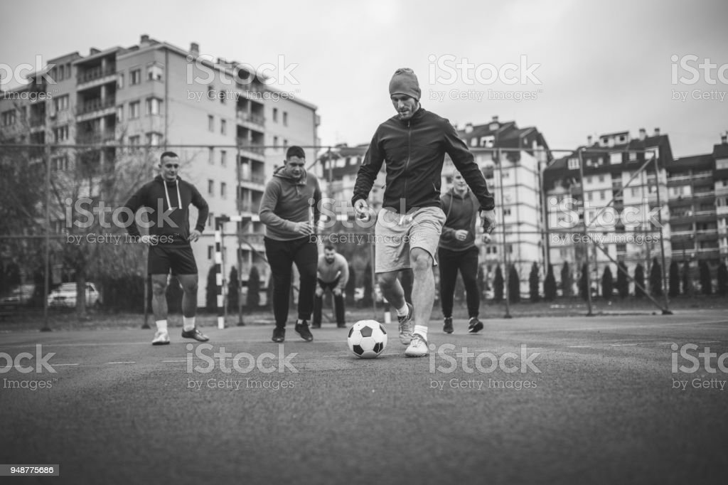 Guys playing soccer stock photo