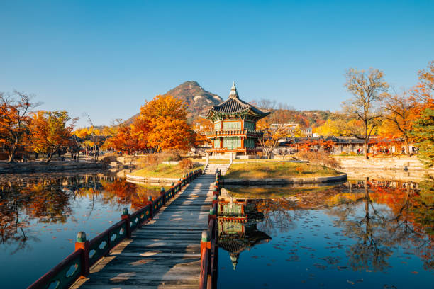 Gyeongbokgung Palace Hyangwonjeong with autumn maple in Seoul, Korea stock photo