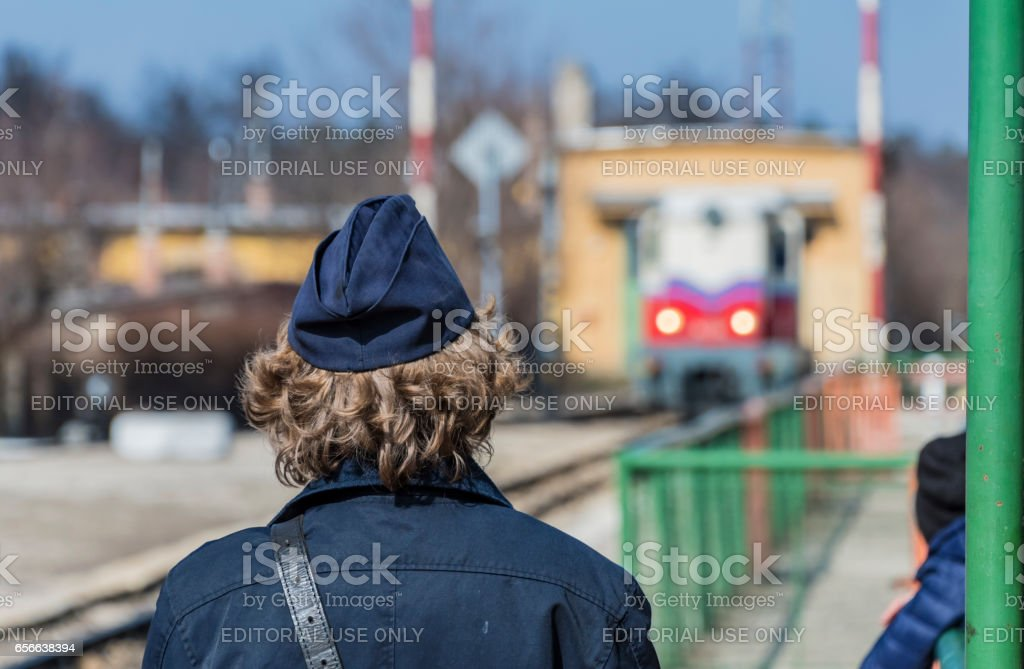 Gyermekvasút Railway Budapest - Guard looks towards train stock photo
