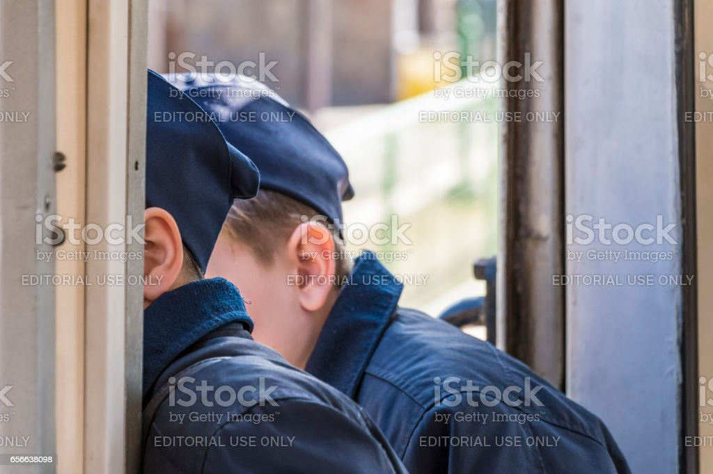 Gyermekvasút Railway Budapest - Guards look out of window stock photo